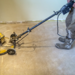 Sanding the dried liquid screed floor
